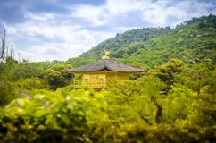 Kinkaku-ji temple / Golden Pavilion. Kyoto. Japan. Kinkakujiis a Zen temple in northern Kyoto whose top two floors are completely covered in gold leaf royalty free stock images