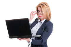 Kinky business woman taking off her glasses Royalty Free Stock Photo