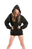 Kinky and sexy young woman wearing a hoodie. Kinky and sexy young woman wearing a black hoodie on white background Royalty Free Stock Image