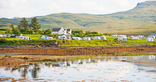 Kinloch campsite Isle of Skye. Campsite at Dunvegan at the northern end of the Isle of Skye with motor homes and towing caravans parked beside the sea Royalty Free Stock Photos