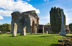 Kinloss Abbey ruins, N Scotland. Near Canarven in the Speyside area of Scotland, the ruins of the 12century Kinloss Abbey stand among gravestones of hundreds of Royalty Free Stock Photos