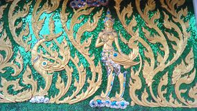 Kinnaree by glass decoration art. According to Indian legend, Kinaree is the female figures of a human being from the forest in the heaven. For Thailand Stock Photo