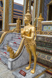 Kinnari statue in the Temple of the Emerald Buddha  complex Royalty Free Stock Images