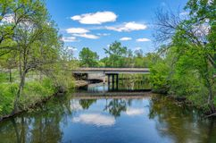 Kinnickinnic River and bridge in River Falls, Wisconsin. Kinnickinnic River and bridge in spring in River Falls, Wisconsin, USA royalty free stock image