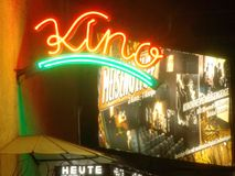 Kino. Enlighted cinema sign by night Stock Images