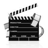 Kino-Klatschen mit Film-Streifen Stockfotos
