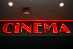 Kino - rote Leuchtreklame Stockfotografie