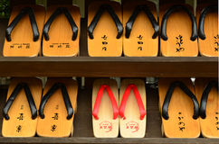 Kinosaki, Japan - June 17, 2011: Rows of traditional Japanese geta sandals at the entrance to a public hot spring Stock Photography