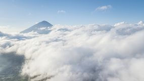 Kintamani volcano covered with mist. Aerial view of Kintamani volcano covered with mist at morning time in Bali, Indonesia Stock Photo