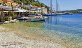 Fishing and tourist boats tied up in Kioni harbour on the clear blue Ionian Sea Stock Photography