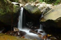 Kionsom瀑布在亚庇,沙巴,婆罗洲 免版税图库摄影