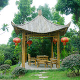Kiosk. In a garden with bamboo chair Royalty Free Stock Photo