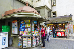 Kiosk in Bern. BERN, SWITZERLAND - SEPTEMBER 11, 2015: Unrecognized passerby do some shopping at a kiosk. Retail sales in heavily used areas provides daily Royalty Free Stock Photography