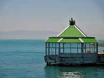 Kiosk on sea. Kiosk with class windows and green roof on sea. Prince islands, Turkey royalty free stock photo