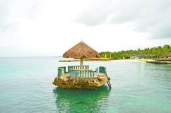 Kiosk on the rock. A beautiful Kiosk on the rock surrounded with clear waters near the island stock photography
