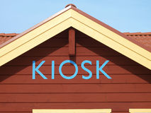 Kiosk sign. A wooden house with a kiosk sign Stock Images