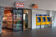 Kiosk and three yellow ticket machines at Dutch railway station royalty free stock images
