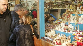 Kiosks with Traditional Christmas toys and gifts. BARCELONA, SPAIN - NOVEMBER 30, 2015: People walking at Christmas fair near Cathedral in Barcelona, Spain