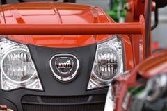 Kioti heavy duty equipment vehicle and logo Royalty Free Stock Photos