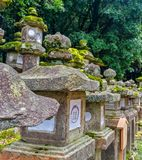 Group of Japanese Stone Lanterns. Kioto, JAPAN - Aug. 02 2017: Group of Japanese Stone Lanterns, focus lanterns stock photos