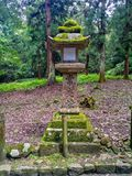 A one Japanese stone lantern. Kioto, JAPAN - Aug. 02 2017: A Japanese Stone Lantern, focus lantern Royalty Free Stock Images