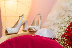 Kippah of groom and wedding rings. Jewish wedding - Kippah of groom and wedding rings on a red velvet pillow Royalty Free Stock Photo