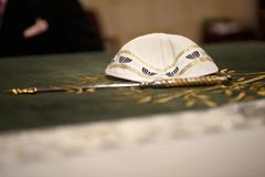 Kippah and yad. On the reading table Stock Photography