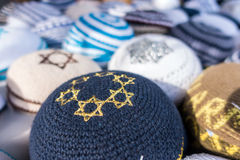 Kippahs. Different colors of yarmulkes on Israeli market. Kippah is a symbol of Jewish people Royalty Free Stock Image