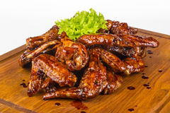 Kippenvleugels in hete saus Stock Foto's