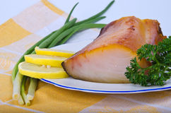 Kipper with greens. On plate Stock Photo