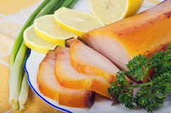 Kipper with greens. On plate Royalty Free Stock Image
