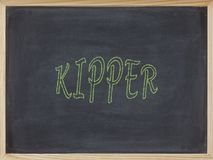 Kipper meat written in green on a blackboard. To mean a business concept Stock Photography