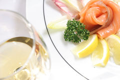 Kipper in slices. Slices of kipper on the plate with lemon Royalty Free Stock Photos