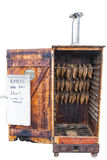 Kipper Smokehouse Isolated. Kipper Smokehouse with burnt bottom edge to the door, Sitting on wheels, and  filled with kippers offered at a £1 each Isolated  on Royalty Free Stock Photo
