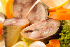 Kipper with vegetables. Horizontal macro photo Royalty Free Stock Image