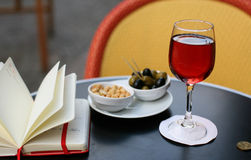 Kir cassis, nibbles and and personal organizer Stock Image