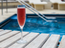 Kir royal. Cocktail of the day: Kir royal near a swimming pool on a summer cruise vacation Royalty Free Stock Photos