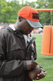 Kirby Wilson RB Coach Cleveland Browns. Kirby Wilson signs a football for a fan during Browns Training Camp in Berea Ohio. Wilson, who has 18 years experience Stock Image