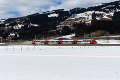 Kirchberg in Tirol, Tirol/Austria: March 28 2019: Public transport small train driving throught the valley. Toward Kirchberg in Tirol stock image