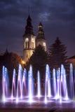 Kirche und ein Brunnen Stockfotografie