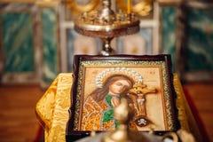 Kirchenikone der Taufe Stockbilder