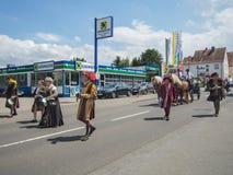 Kirchheimbolanden,Rheinland-Pfalz,Germany-06 23 2019: Holiday parade on streets of German town during Beer Festival week. Walking people wearing medieval royalty free stock image
