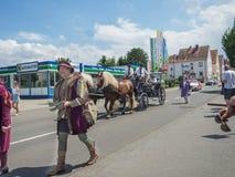 Kirchheimbolanden,Rheinland-Pfalz,Germany-06 23 2019: Holiday parade on streets of German town during Beer Festival week. Walking people wearing medieval stock photo