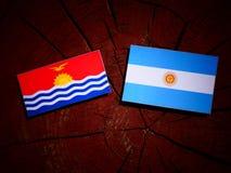 Kiribati flag with Argentinian flag on a tree stump isolated Stock Photos