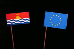 Kiribati flag with European Union EU flag isolated on black. Background Royalty Free Stock Photos