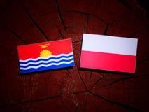 Kiribati flag with Polish flag on a tree stump isolated. Kiribati flag with Polish flag on a tree stump royalty free illustration