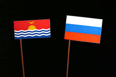 Kiribati flag with Russian flag isolated on black Stock Image