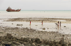 Kiribati shipwreck and children Stock Image