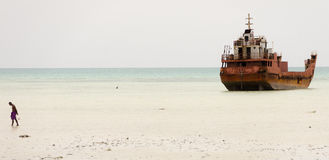 Kiribati shipwreck and man Royalty Free Stock Photography