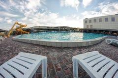 Kirillovka, Ukraine - August 28, 2016: Sunbeds are near the pool royalty free stock image